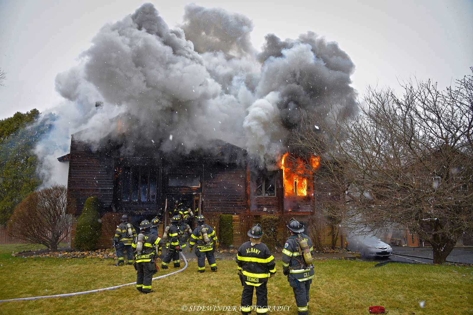 Firefighters on scene at a raging house fire in Albany