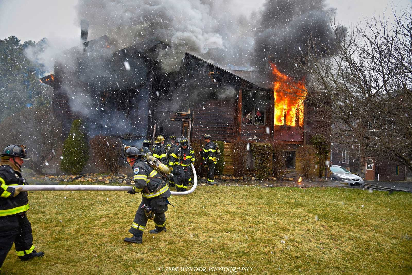 Firefighters control a house fire in Albany, New York