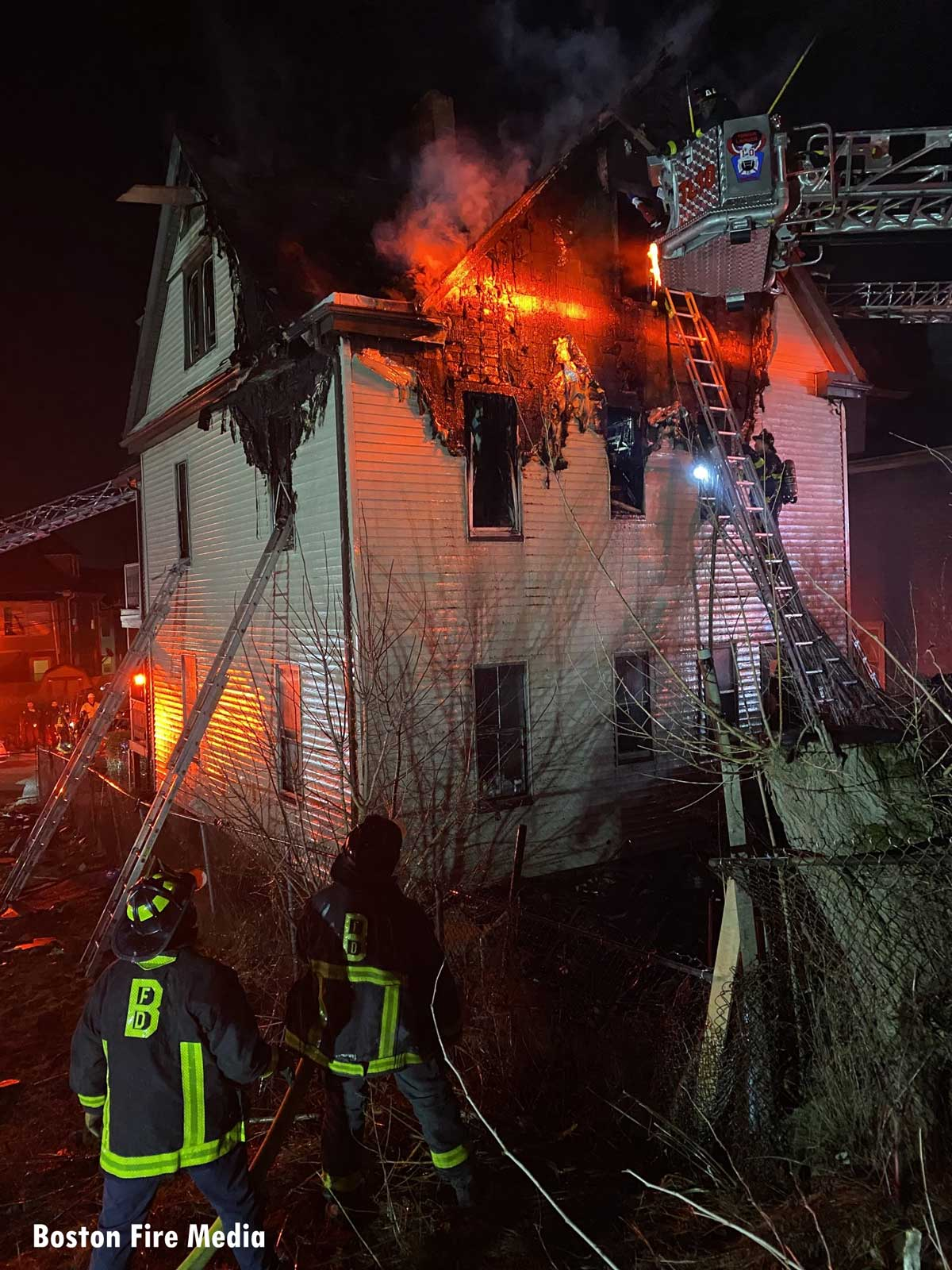 Firefighters operating at a major fire in Dorchester section of Boston