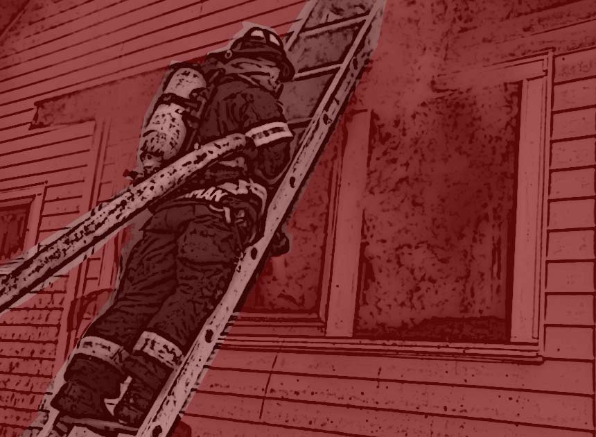 Firefighter with a hose on a ladder