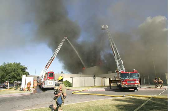 Big water delivery to fire; multiple aerial devices at work