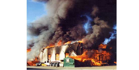 Structure fully engulfed in flames