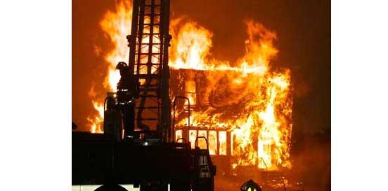 Flames tear through a structure