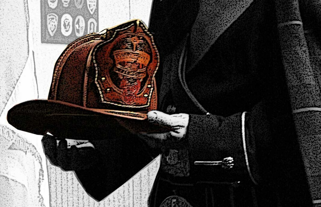 Honor guard member holding a fire helmet
