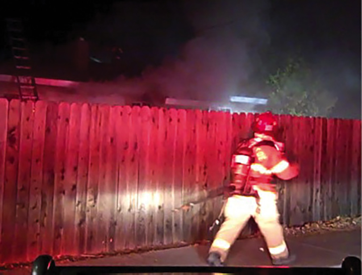 Limited view from the ICP of a house fire at night. (Photos courtesy of author.)
