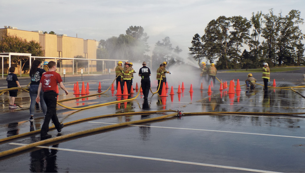 """Parking lot"" hose and fire attack evolutions can prove to be valuable and effective when introducing rookie members to the art of hose handling and fire streams."