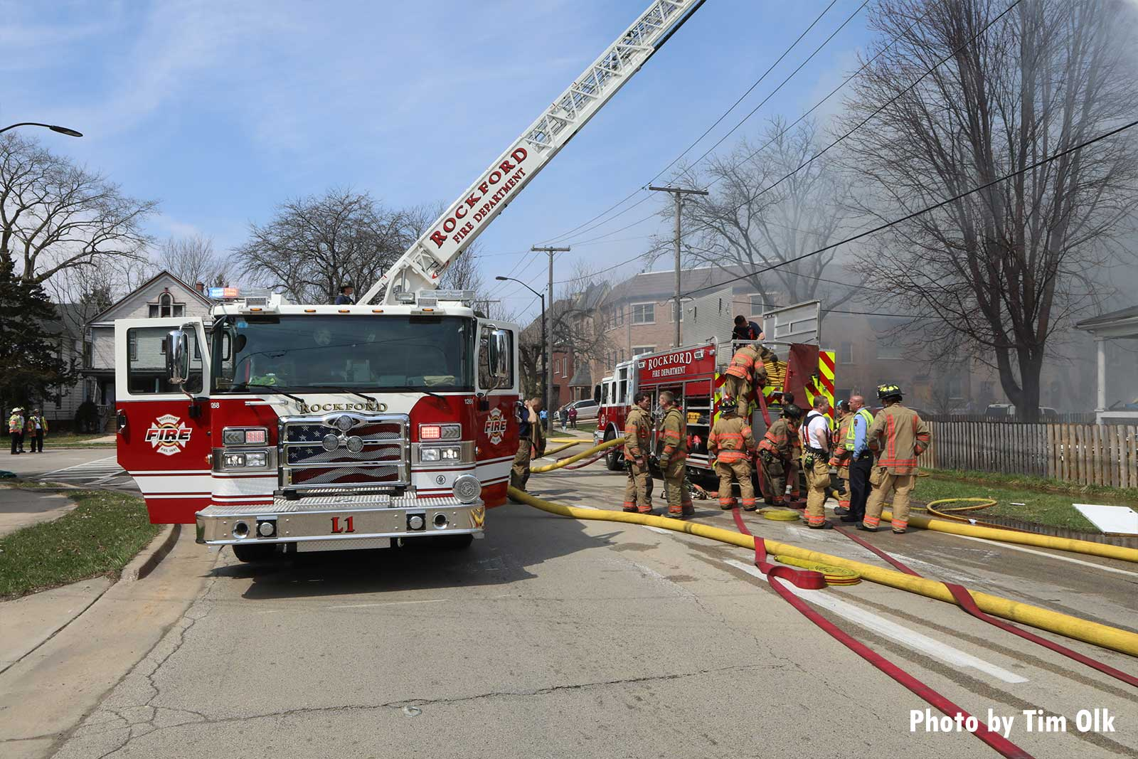 Firefighters and aerial on scene at apartment fire