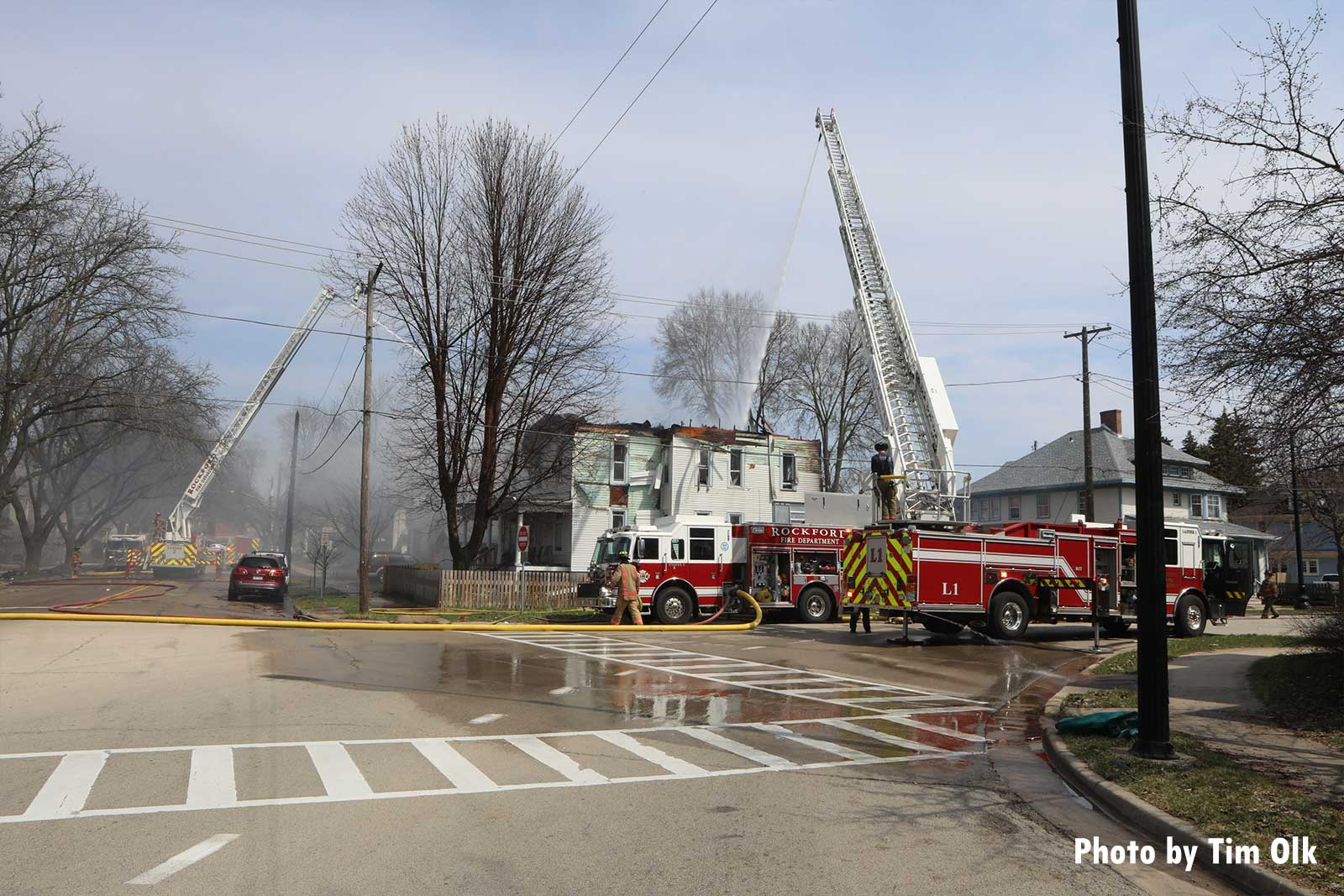 Firefighters and apparatus on scene at the fire