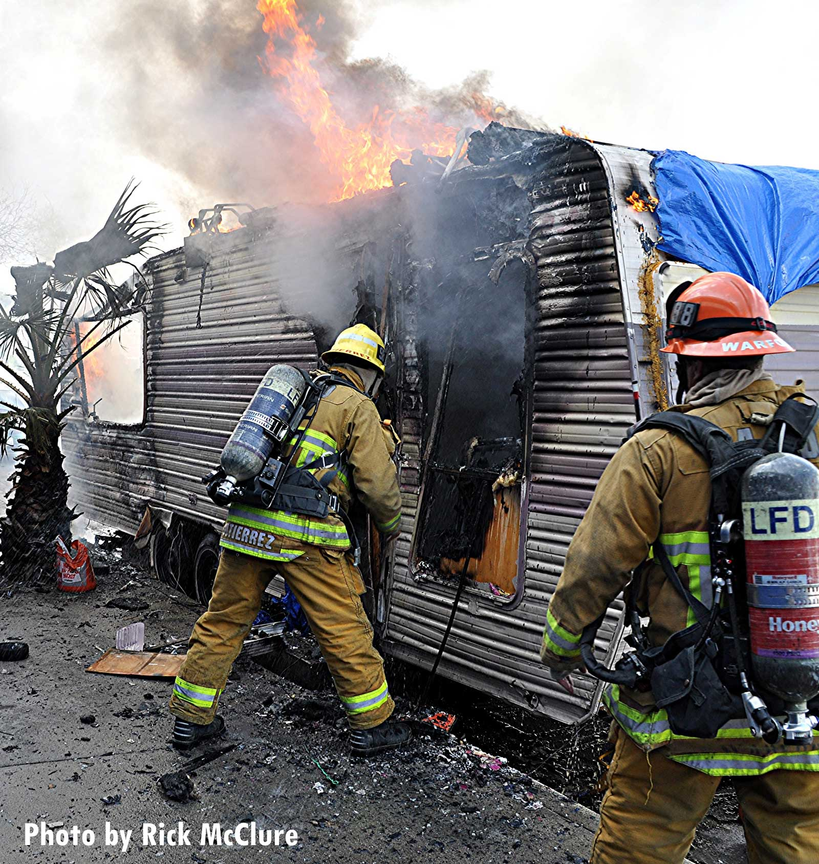 Firefighters at the scene of a trailer fire in Los Angeles