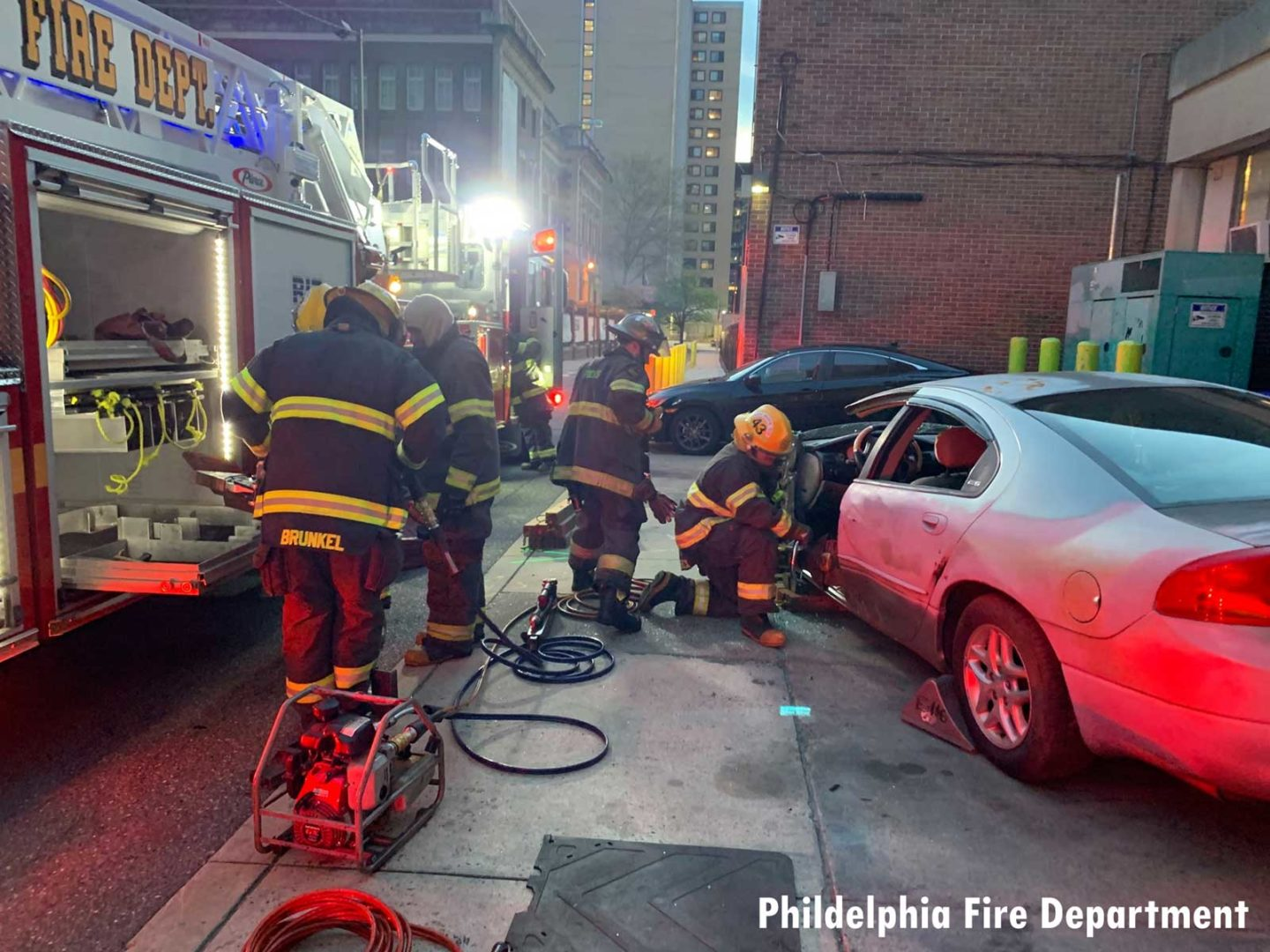 Firefighters working on vehicle extrication