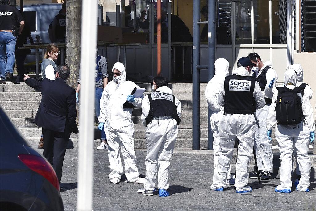 Responders in full PPE at scene of mass stabbing in France