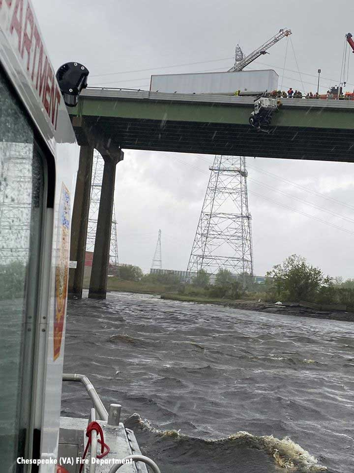 A view from a fireboat of the cab dangling off the bridge