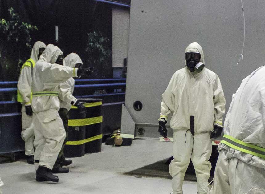 Hazmat team members in hazmat suits