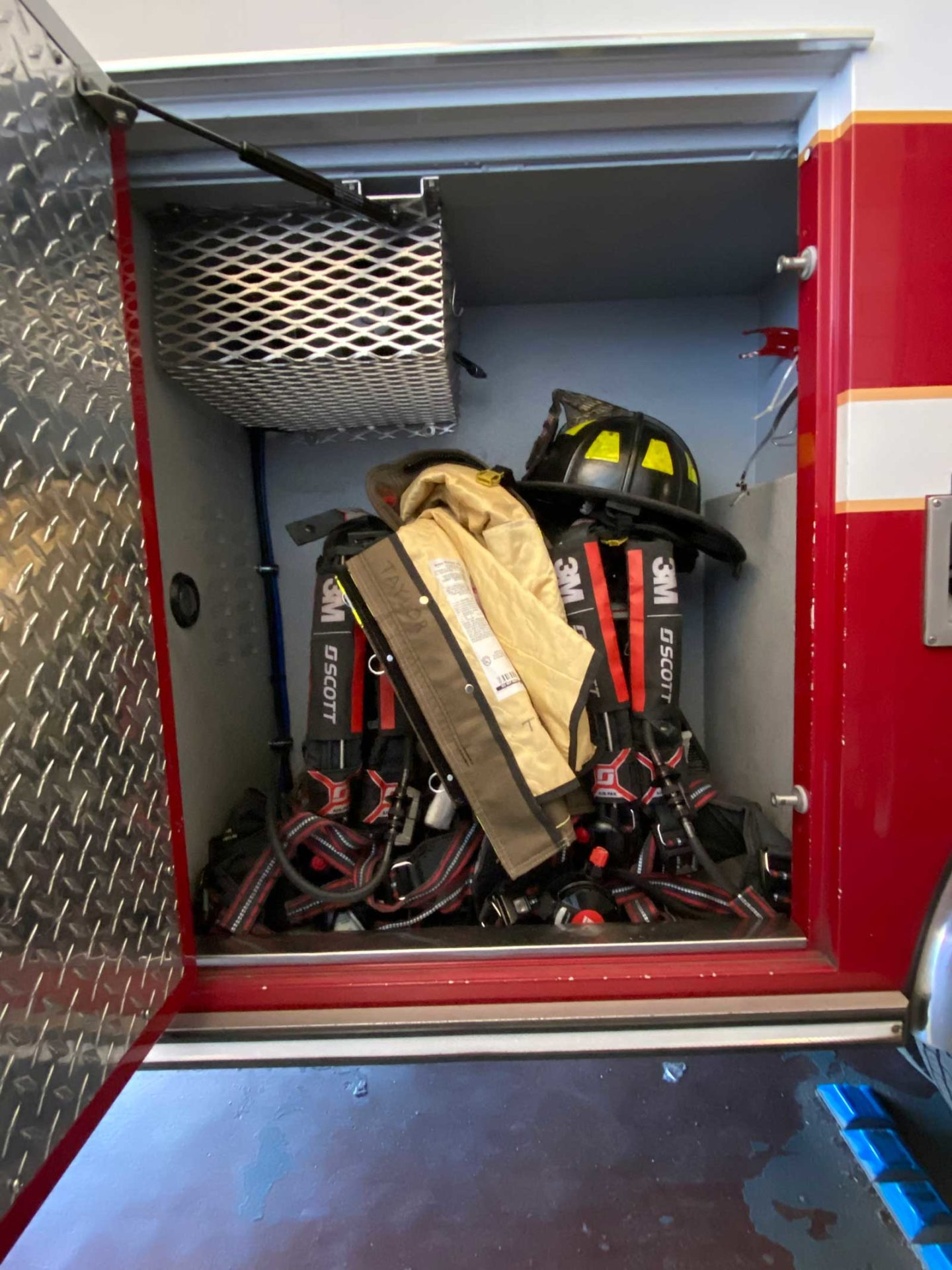 Firefighter gear in a compartment on a fire truck
