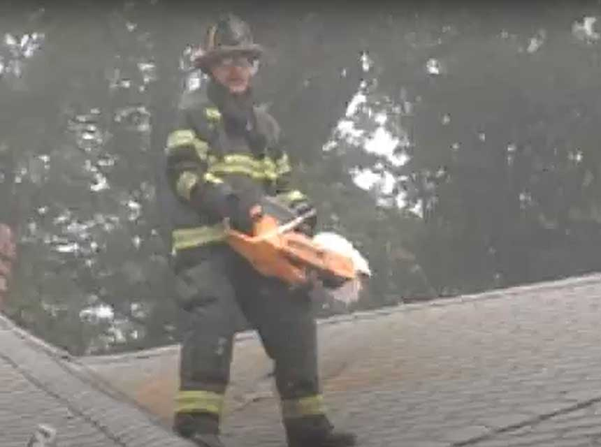 Mike Ciampo with rotary saw on a roof