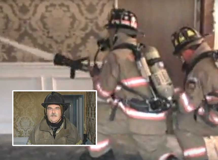Ray McCormack with firefighters on a hoseline