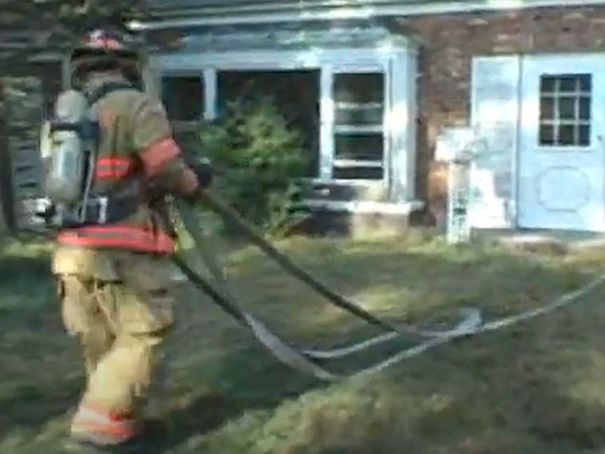 Firefighter flaking out a hoseline