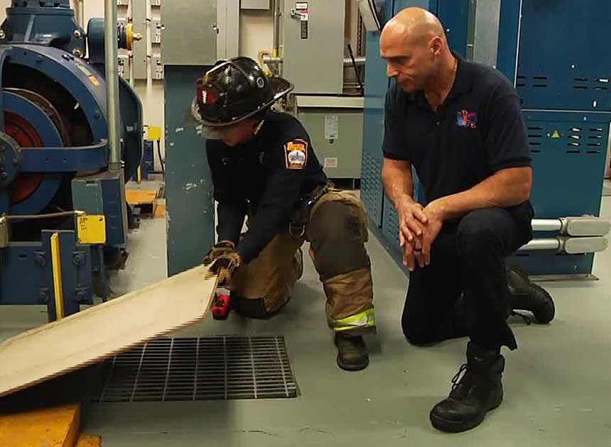 Mike Dragonetti and another firefighter in the elevator machine room