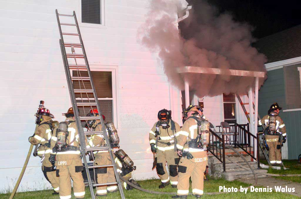 Firefighters working at a dwelling fire in Royal Oak, Michigan