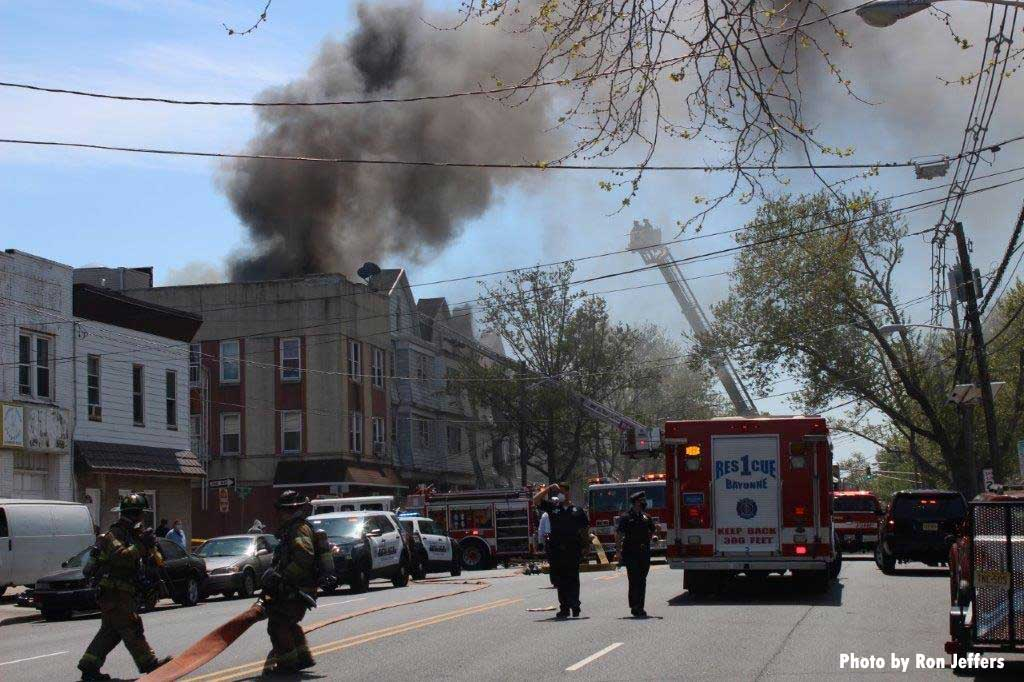 Firefighters and apparatus at a four-alarm Bayonne fire