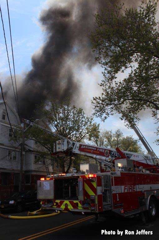 Smoke rises from the multifamily dwelling in Bayonne