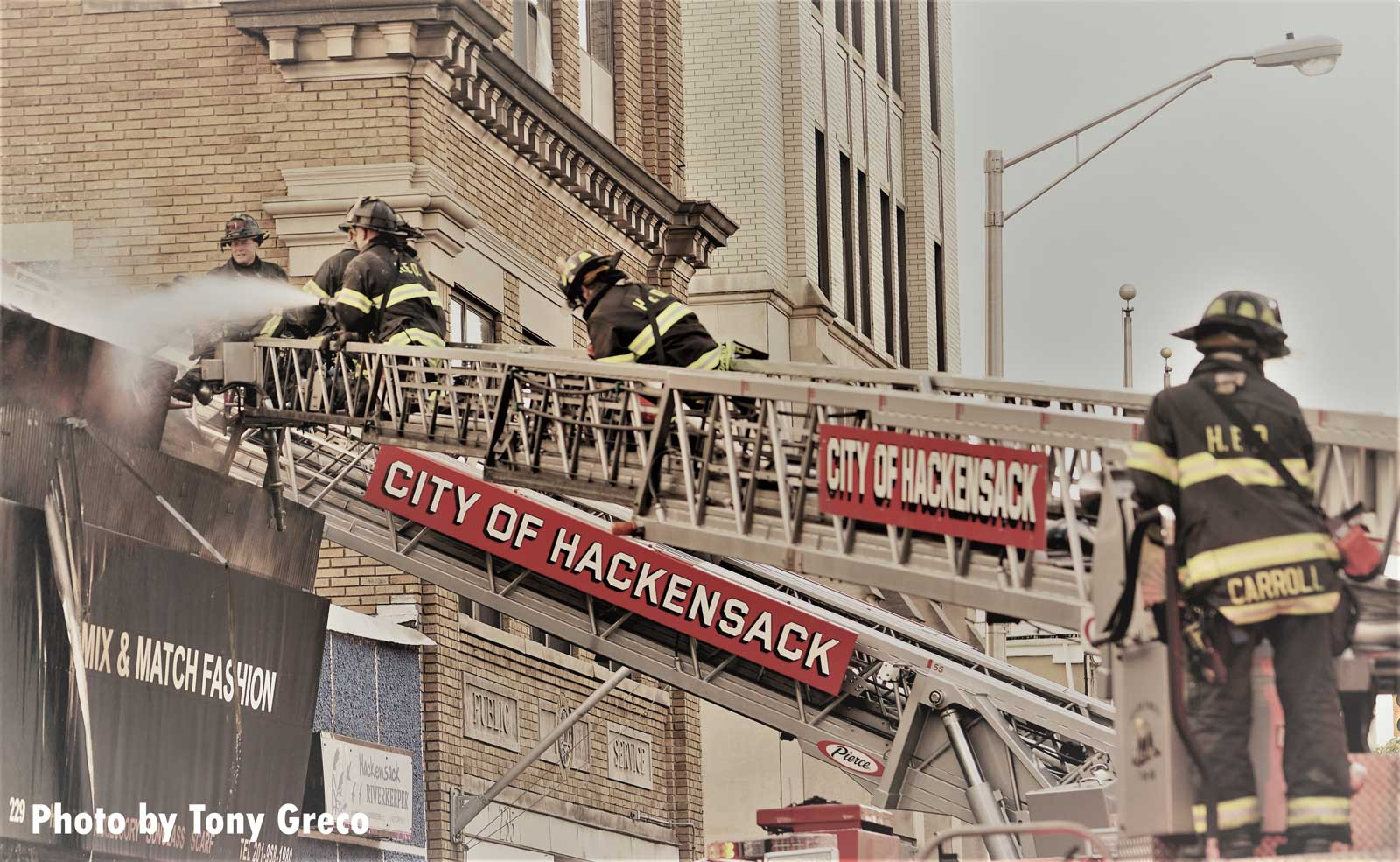 Hackensack firefighters on an aerial device