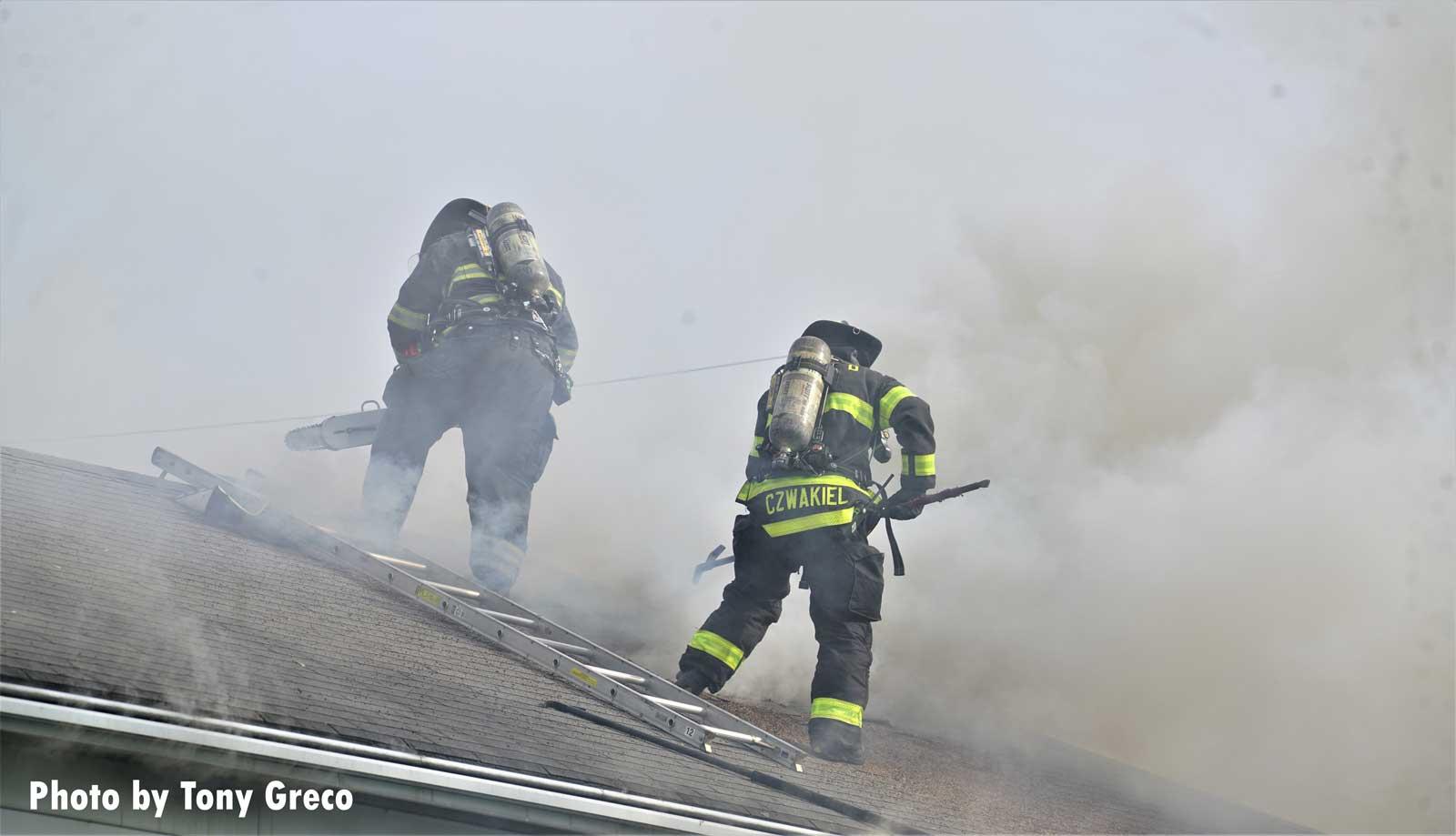 Fierfighters work on vertical ventilation