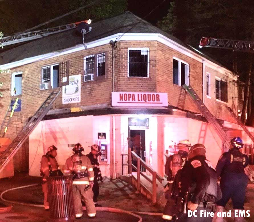 Exterior of the building as firefighters work