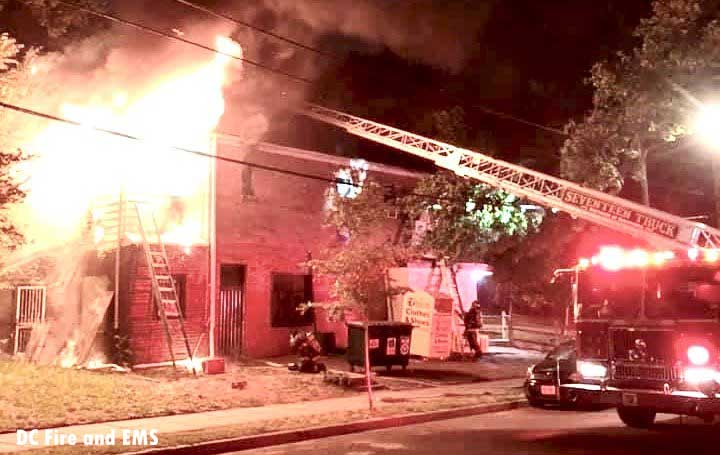 Firefighters working as flames rage in a building in Washington, D.C.