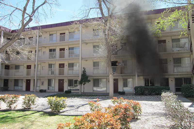 Smoke arises from a garden apartment