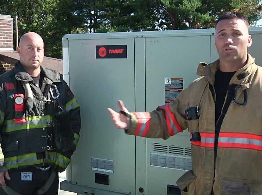 Anthony Deko and Adam Hansen on rooftop unit investigation