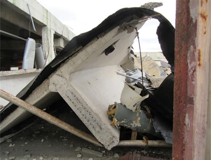 The east end of the single T-beam that fell from the roof.