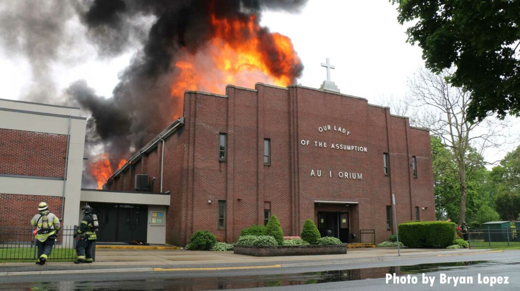 Firefighters respond to a church fire wit flames raging through the roof