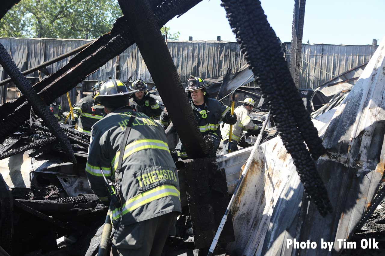 Firefighters work in the debris of a building following a fire