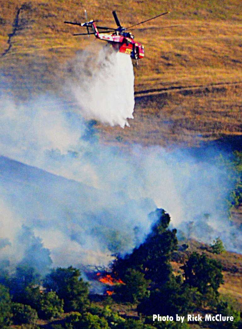 Helicopter with smoke from Lime Fire