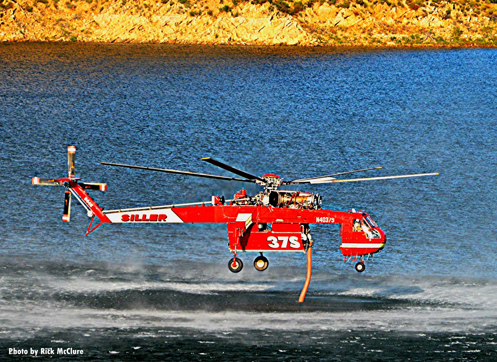 Helicopter gathering water for drop