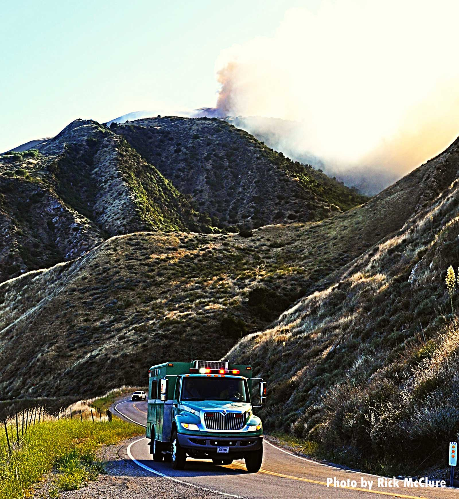 Truck with smoke from Lime Fire in background
