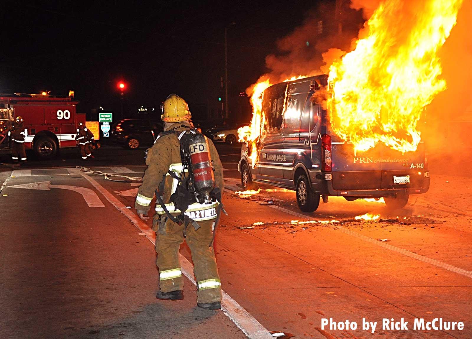 Firefighter facing an ambulance fire