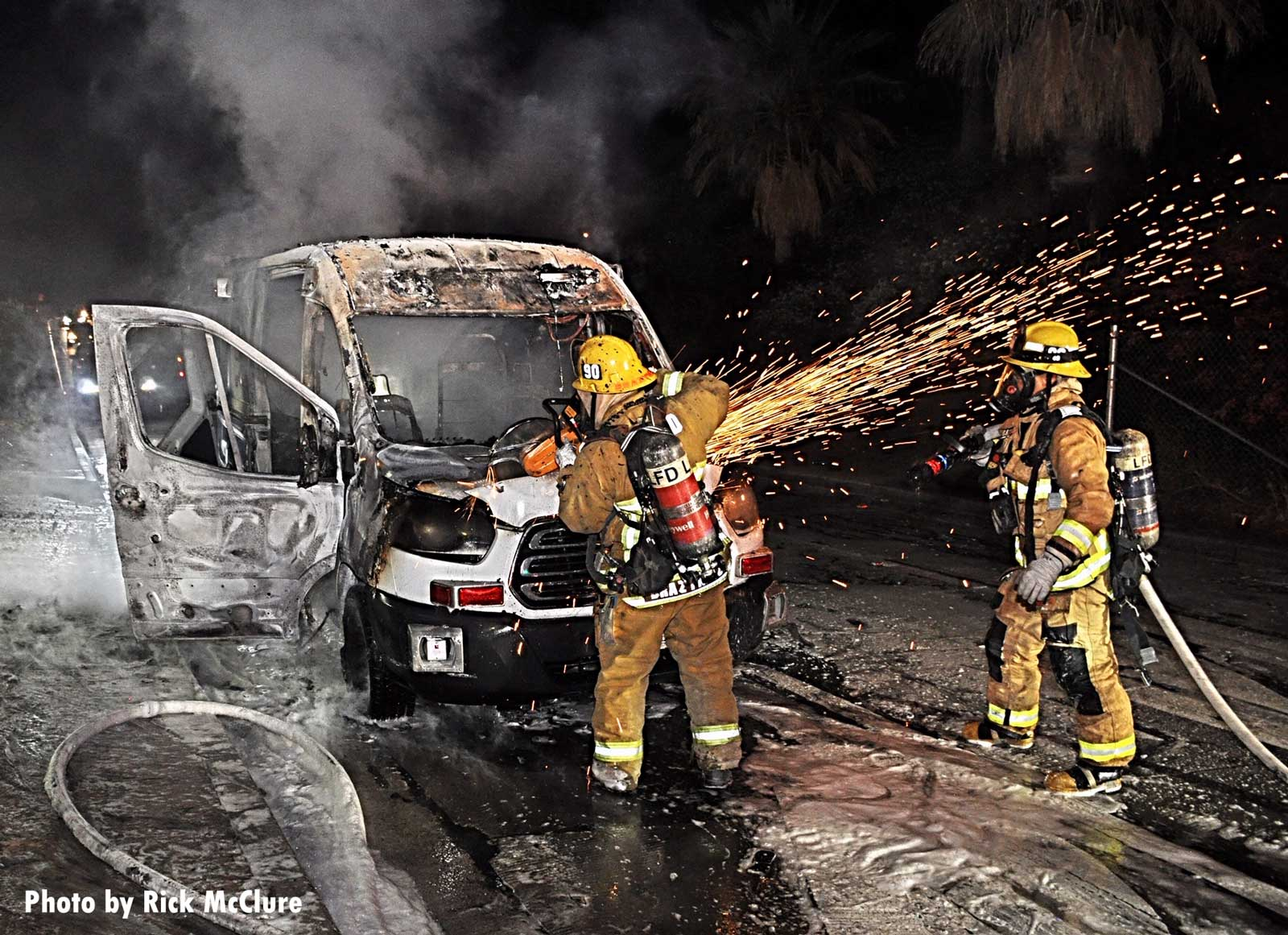 Firefighters cut into the vehicle to extinguish the fire