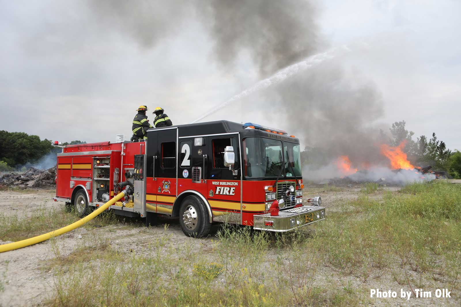 Fire truck with master stream on outdoors fire