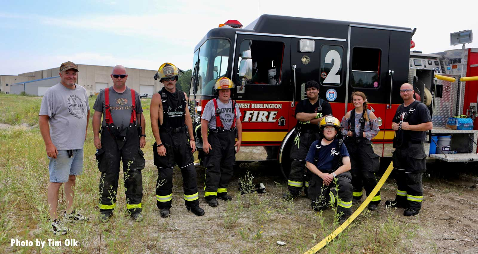 Firefighters in front of a fire truck