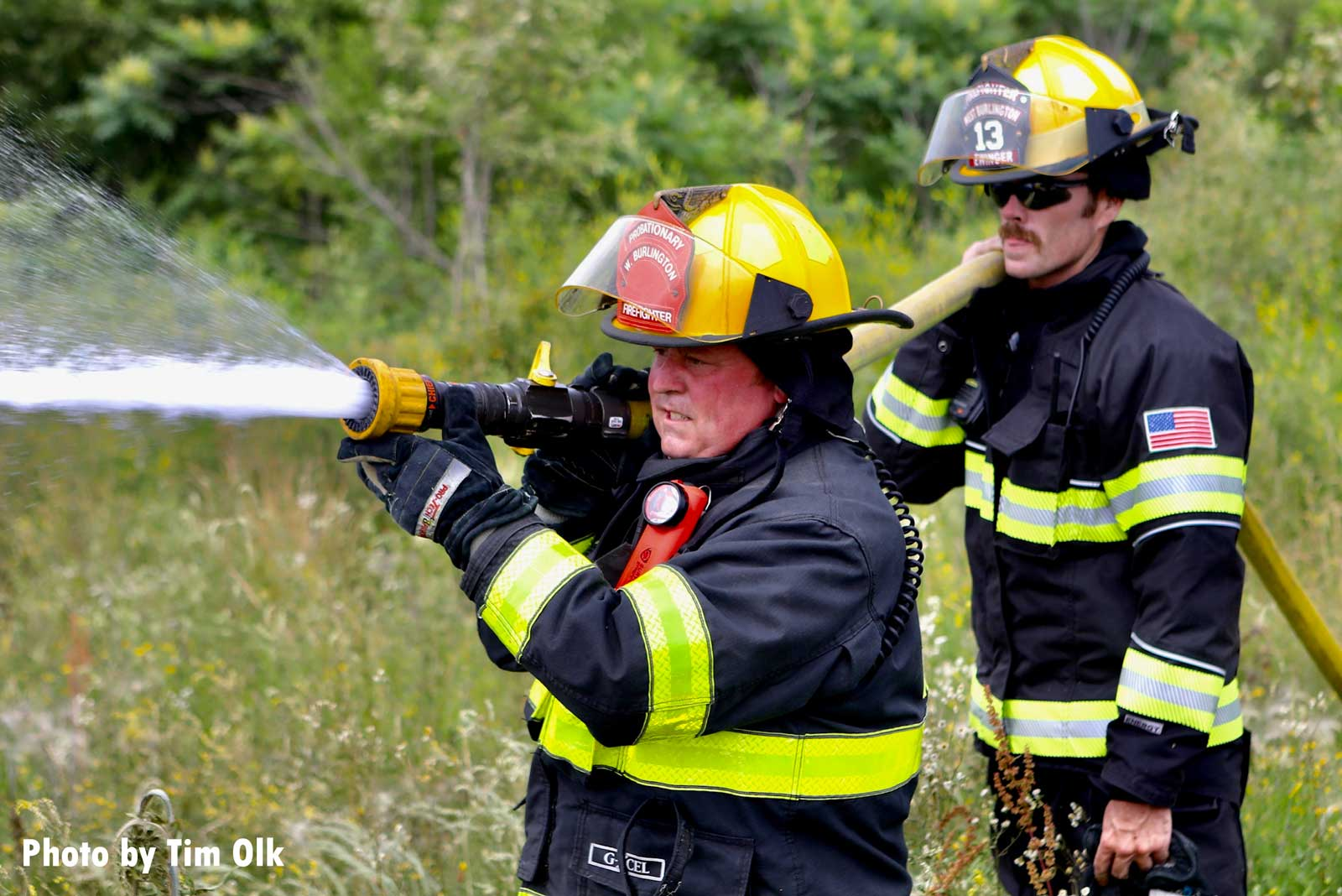 Firefighters with a hoseline