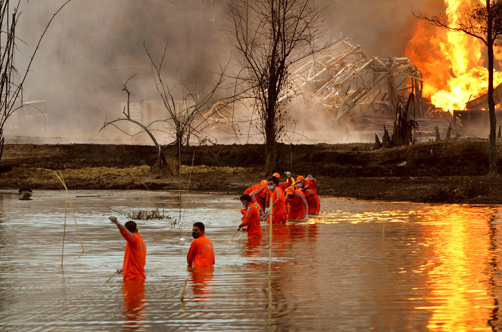 Firefighters at India gas fire