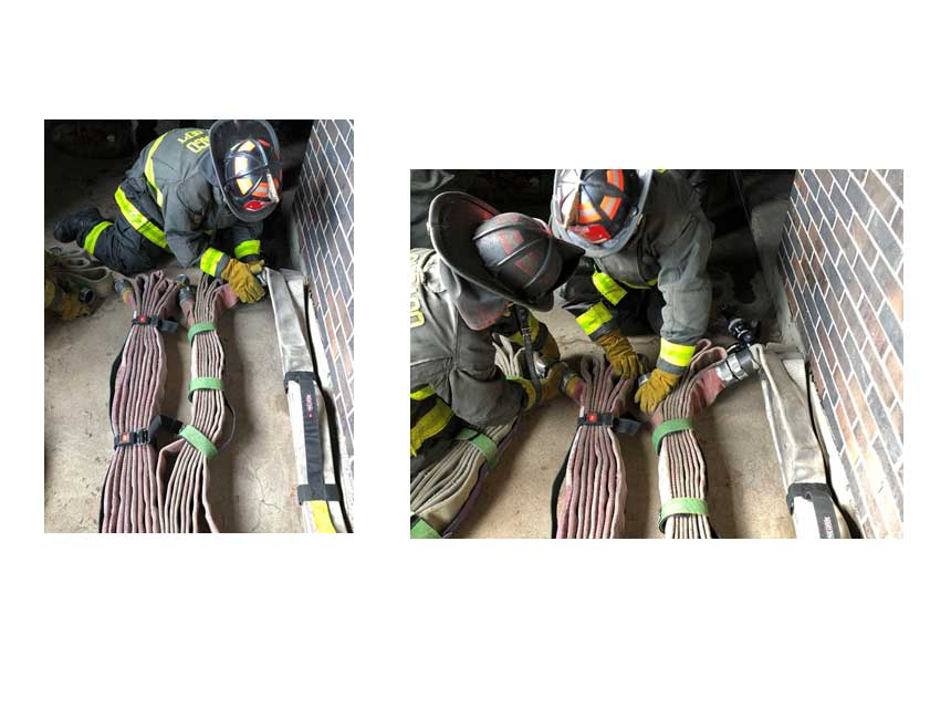 Firefighters dealing with hose packs