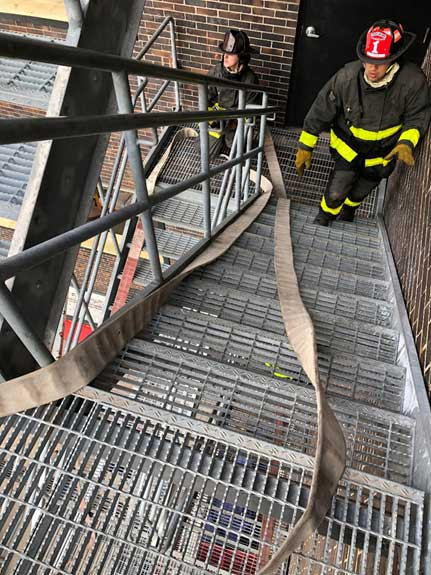 Flaking a hose up stairs