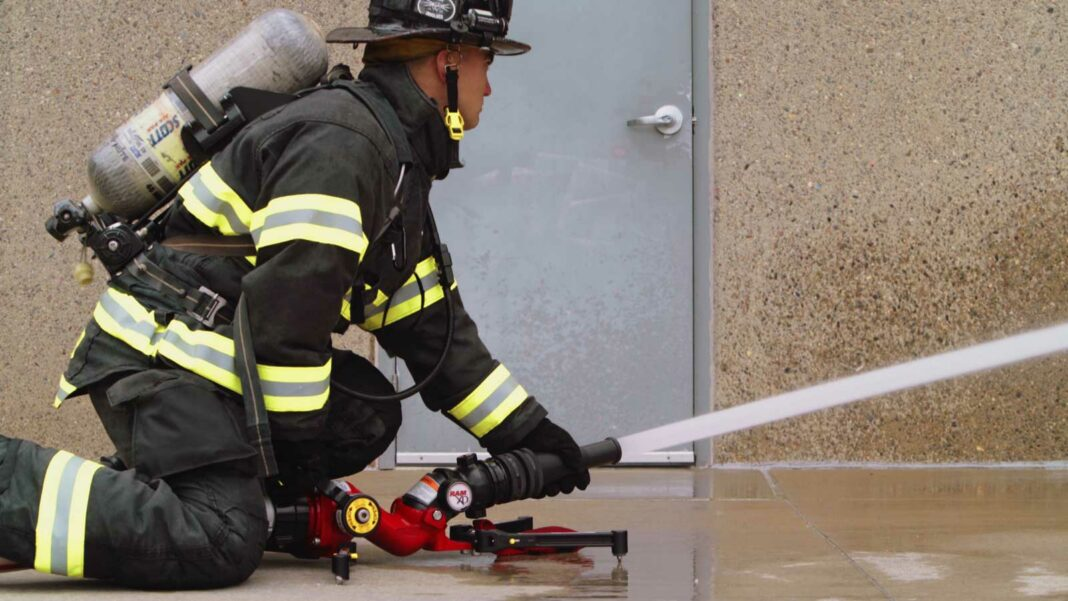 Firefighter using a portable ground monitor