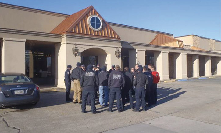 Firefighters preplanning a converted commercial target hazard in their first-due area. Originally a movie theater, this structure is now a furniture showroom and warehouse.