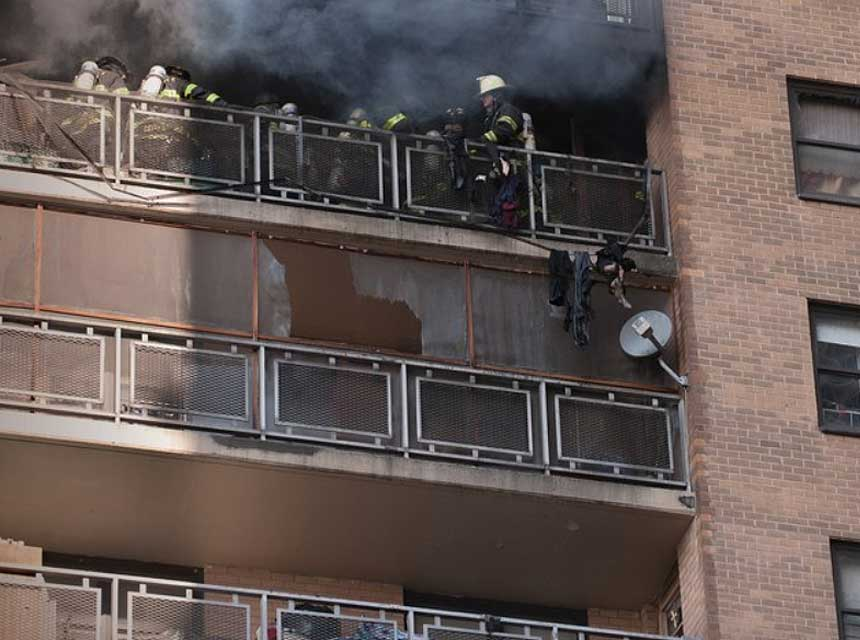 FDNY firefighters work at a high-rise fire