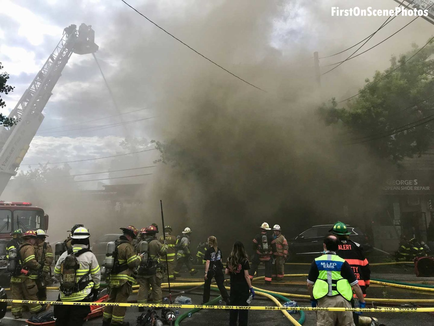 Firefighters enveloped at the scene of the fire