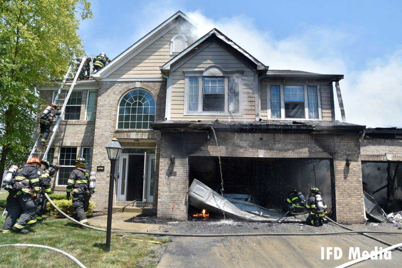 Indy firefighters operating a house fire